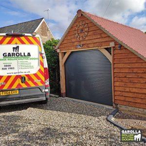 Single Roller Garage Door in Black - 55mm Slats